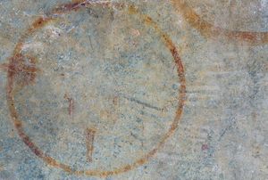 circular rust stain on concrete ground