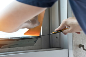 Man attaching window film