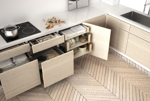Cupboards and drawers ajar in a kitchen