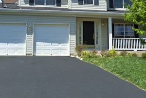 asphalt driveway in front of a house