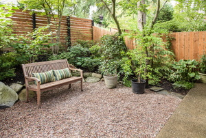Outdoor sitting area with plants and privacy fence