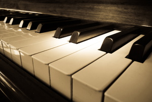 A close up on piano keys.