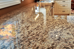 A pristine, polished granite countertop in a new kitchen.