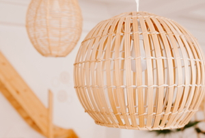 hanging lights in round natural wood chandelier enclosures