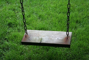A wooden swing set.