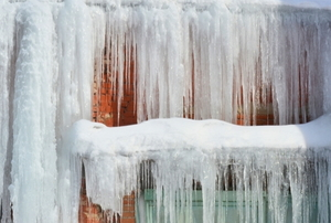 heavy ice hanging off of a house