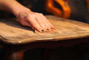 A woman works on a table.