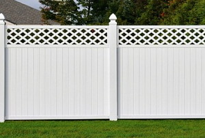 a tall, white privacy fence