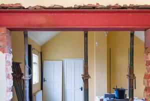 steel beam in masonry pockets above door under construction