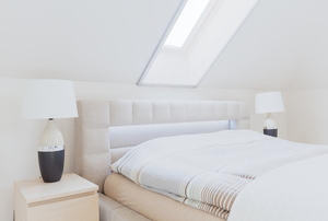 a skylight in a white bedroom