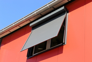 Sun shades on a red house.