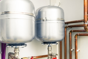 Metal hot water tanks.