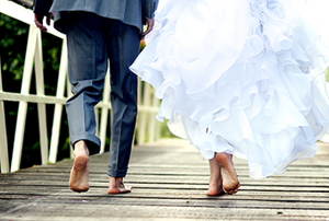 a bride and groom in bare feet