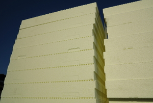 A large stack of thick pieces of foam board insulation.