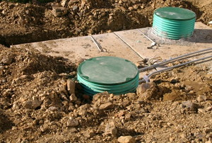 Septic tank lids uncovered in the ground