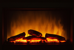 An electric fireplace that is switched on.