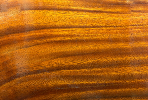 A glossy, lacquered wood surface.