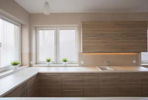 bright windows surrounded by brown cabinets