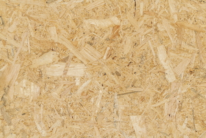 A close-up of a slab of light colored plywood.