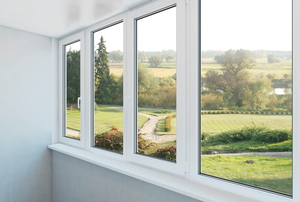 A set of four windows with vinyl frames.