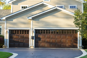 Two garages in the front of a house.