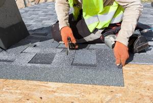 roofer installing starter shingles
