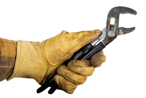 A hand in work gloves holding black-handled pliers.