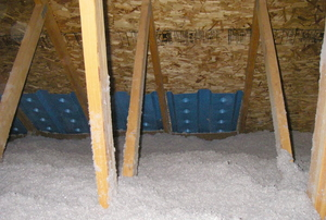 Blown cellulose insulation in an attic.