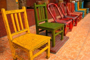 A row of shabby chic, painted furniture.