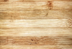 Various scratches damage the surface of hardwood flooring.
