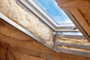 fiberglass insulation in a skylight opening