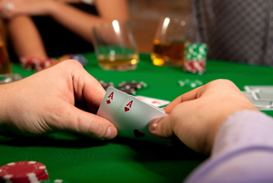 A group plays poker.