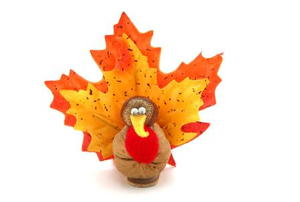 A Thanksgiving turkey made from a walnut and leaves.