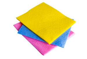 A stack of cloths in pink, blue, and yellow.