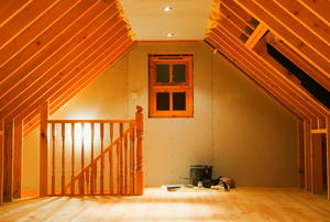 A newly-finished attic with tools still on the floor.