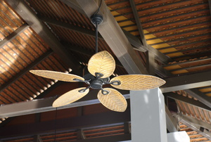 ceiling fan mounted to a beam on a high ceiling
