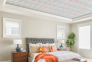 A bedroom with a wallpaper statement ceiling