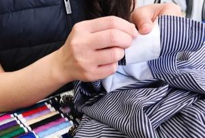 A woman sews.