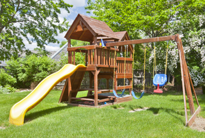 a large wooden swing set with slide
