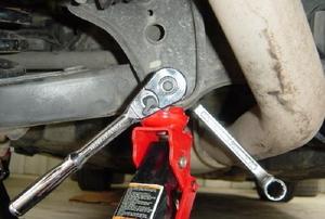 A closeup image of a car's control arm.
