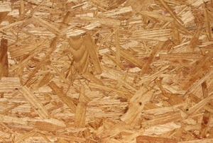 A close-up image of oriented strand board.