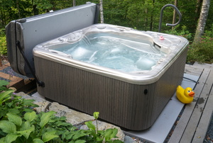 hot tub on a small deck with cover off
