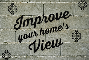 "The phrase, ""Improve your home's view"" on a cinderblock brick wall"