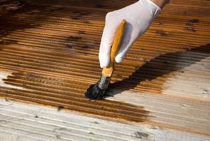 applying coat of deck stain
