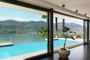 glass sliding patio doors leading to backyard pool