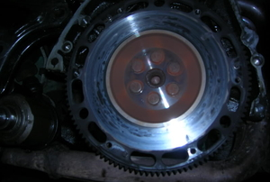 A close-up of the car flywheel in a Honda Civic.