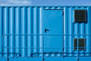 A smooth, blue paint job on a metal door.