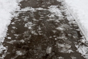 An iced-over walkway outside a home.