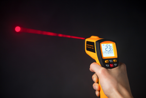 infrared thermometer with red laser light