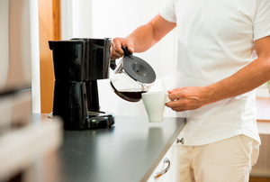 A man pours coffee.